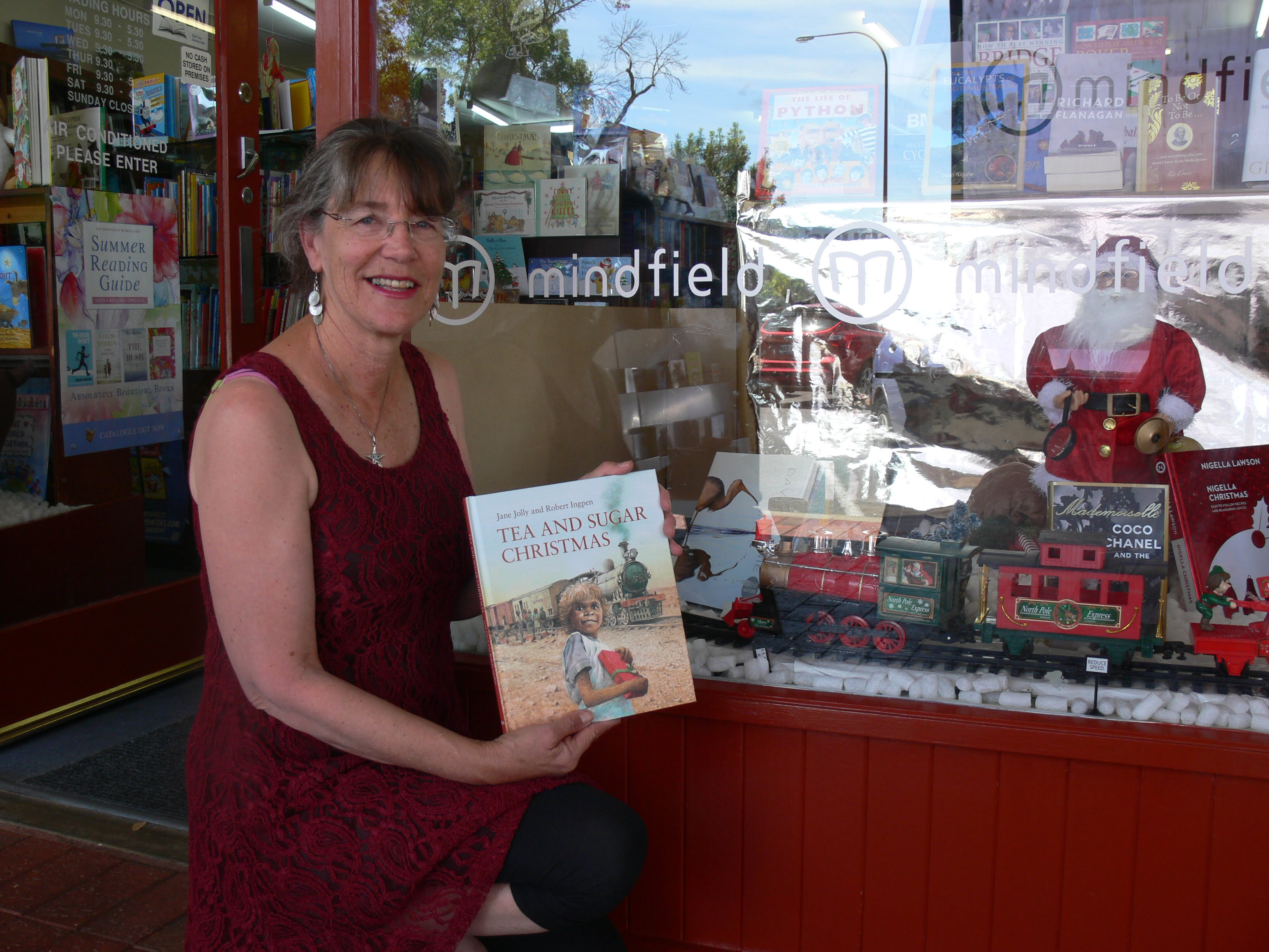 In front of the beautiful Christmas window at Mindfield Books at Blackwood...soon to be Shakespeare's. There was a gorgeous Christmas train on display.