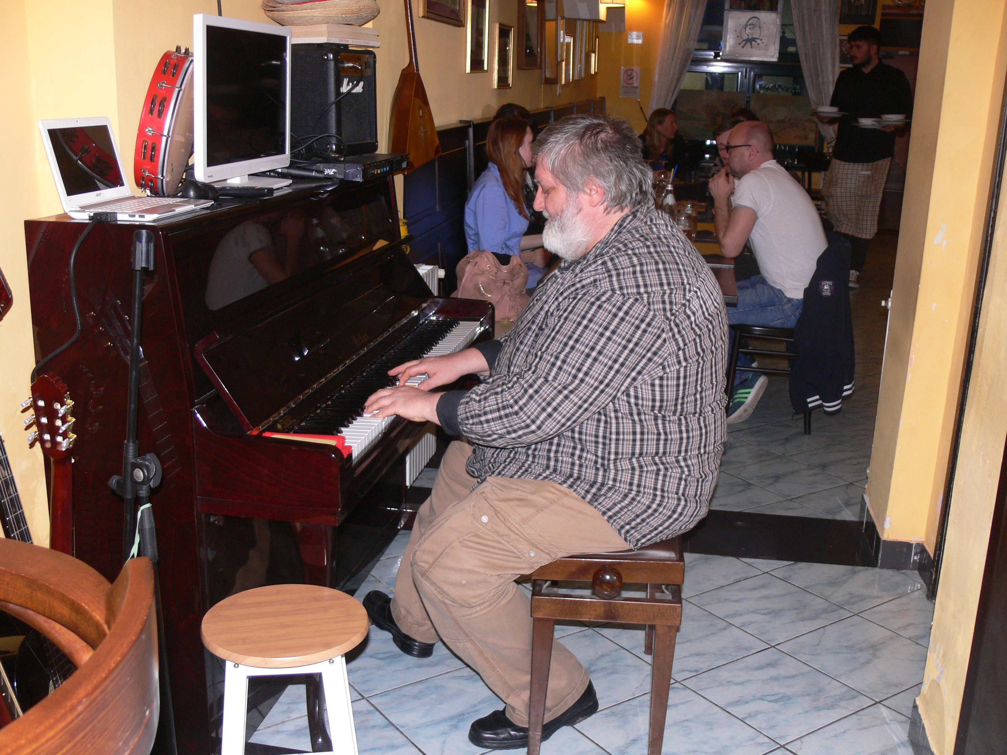 Papa Guisseppe playing the piano at the cafe where we ate